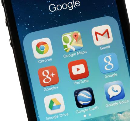 Colorado Springs, Colorado, USA - November 26, 2013: A group of Google apps on an iPhone 5s running iOS7.