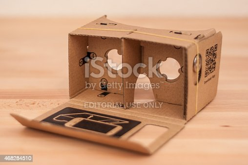 London, England - March 29, 2015: Google Cardboard is an open source  virtual reality headset made from cardboard that uses a modern smartphone. The plans can be downloaded from the internet and edited for your needs, The kit also includes a magnet that works as a switch, two lenses and an RFID tag.