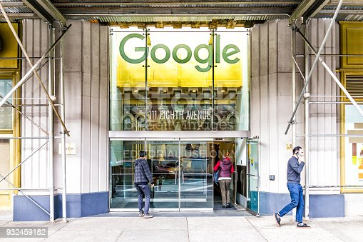 istock Google company office green sign in downtown lower Chelsea neighborhood district Manhattan NYC, people entering, exiting doors entrance 932459182