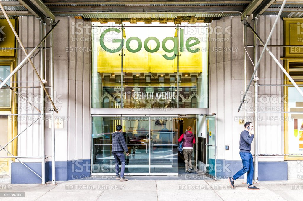 Google company office green sign in downtown lower Chelsea neighborhood district Manhattan NYC, people entering, exiting doors entrance stock photo