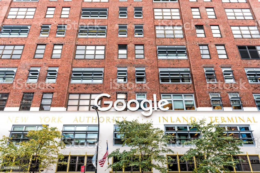 Google company office green sign in downtown, lower Chelsea neighborhood district Manhattan NYC, with nobody, scaffold construction stock photo