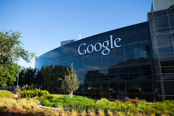 Google Headquarters Mountain View, USA - August 28, 2015: Big Google logotype on the glass office building at Google Headquarters office located at Mountain View, California google stock pictures, royalty-free photos & images