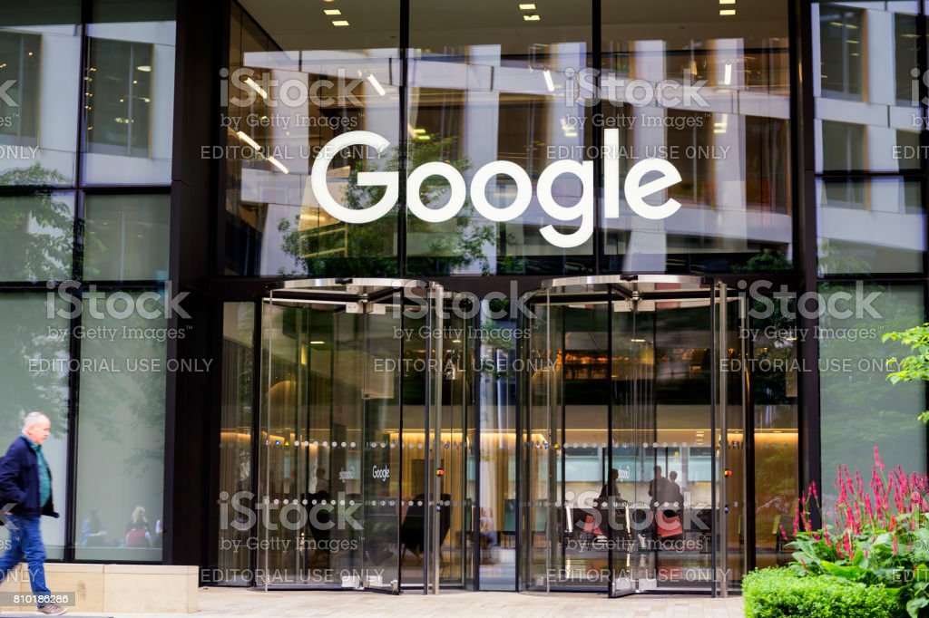 Google headquarters with brand name above entrance in London stock photo