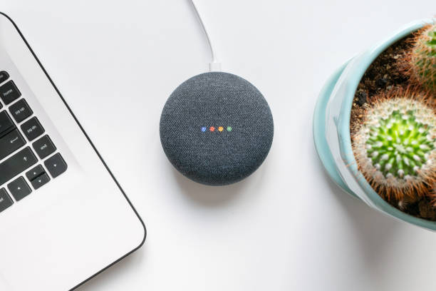 google home mini smart speaker with built in google assistant - assistant stock pictures, royalty-free photos & images