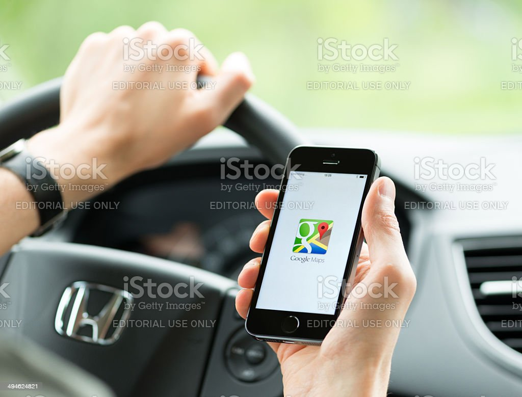 Google Maps Application On Apple Iphone Stock Photo ... on android download free, 3d street maps free, google earth 2012, animation download free, street map template free, map clip art free, google maps print free,
