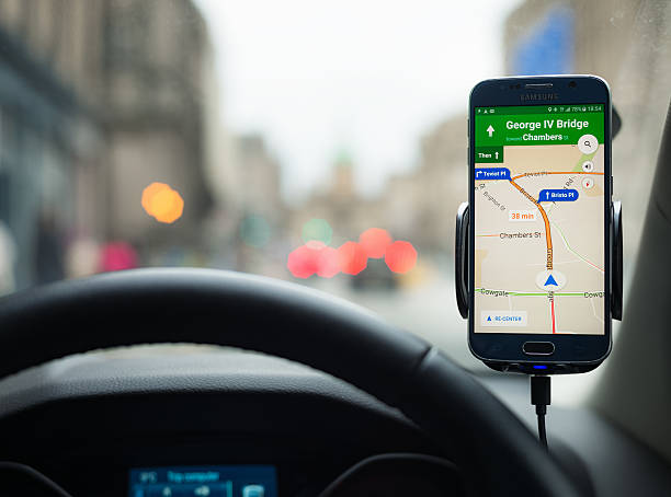 Google Maps Navigation on a Samsung S6 smartphone Edinburgh, UK - April 14, 2016: A Samsung S6 smartphone being used in a car, running Google's Maps navigation software for driving directions. global positioning system stock pictures, royalty-free photos & images