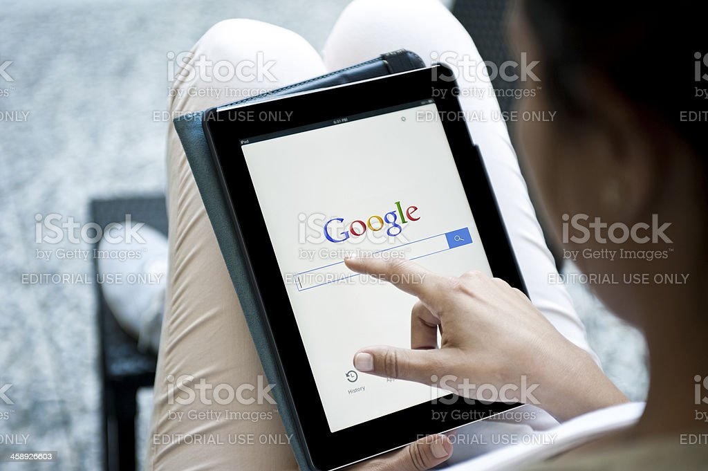 Google on iPad 2 stock photo