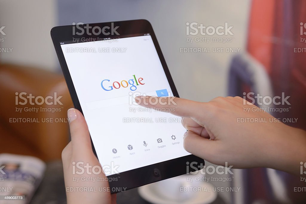 Google on iPad Mini stock photo