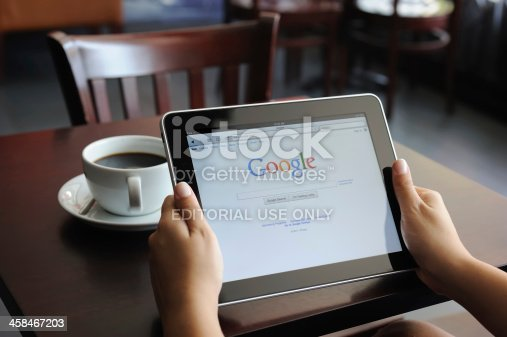 Astanbul, Turkey - July 15, 2011:Hand holding a digital tablet with Google site.Google Inc. is an American multinational public corporation invested in Internet search, cloud computing, and advertising technologies.