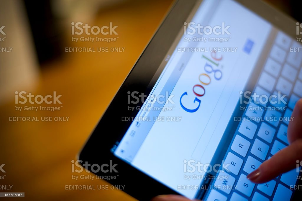 Google on iPad2 screen stock photo