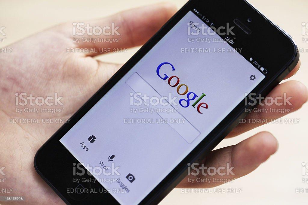 Google on iPhone 5 stock photo