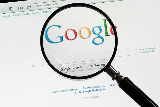 """Google """"Utrecht, The Netherlands - June 12, 2011: A magnifying glass on the Google homepage. Google is the most popular web search engine."""" google stock pictures, royalty-free photos & images"""