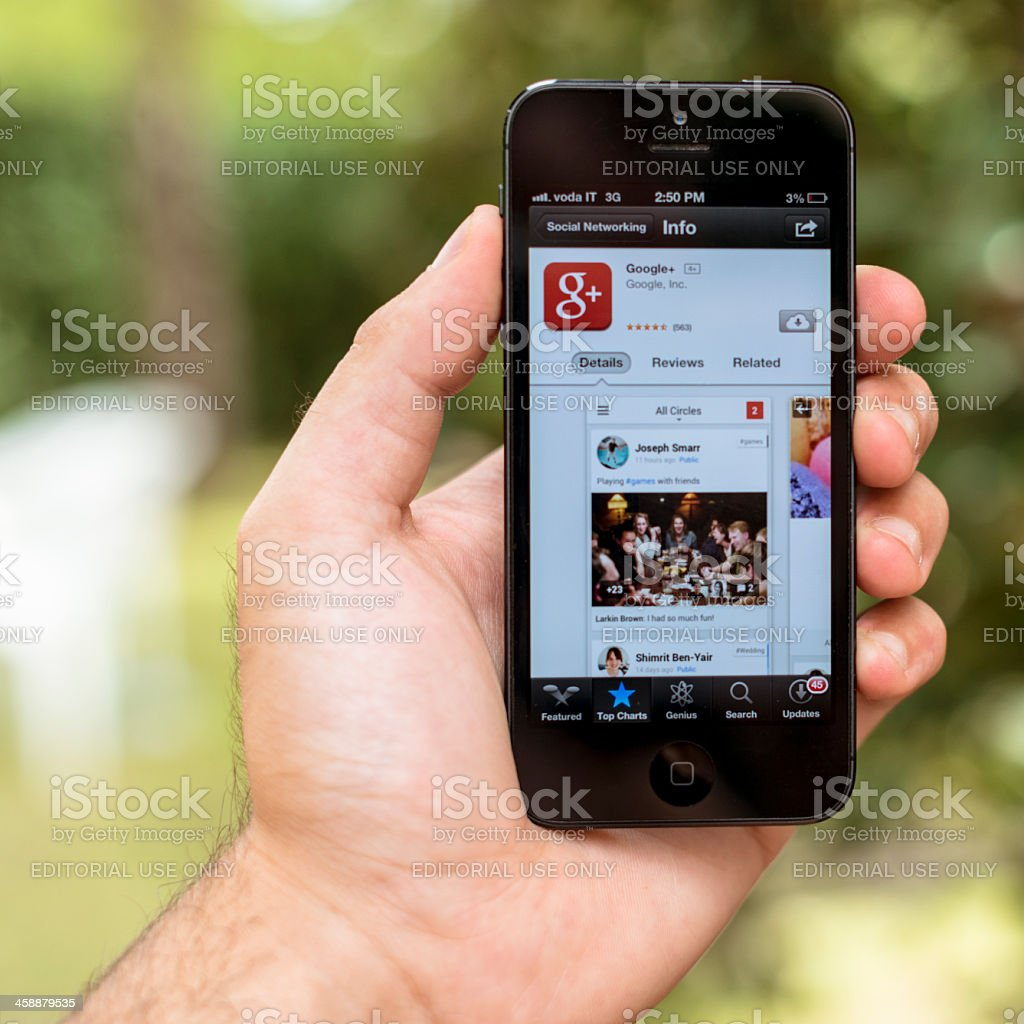 google plus app on smarthphone Iphone 5 royalty-free stock photo