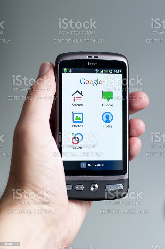 Google Plus on a mobile phone royalty-free stock photo
