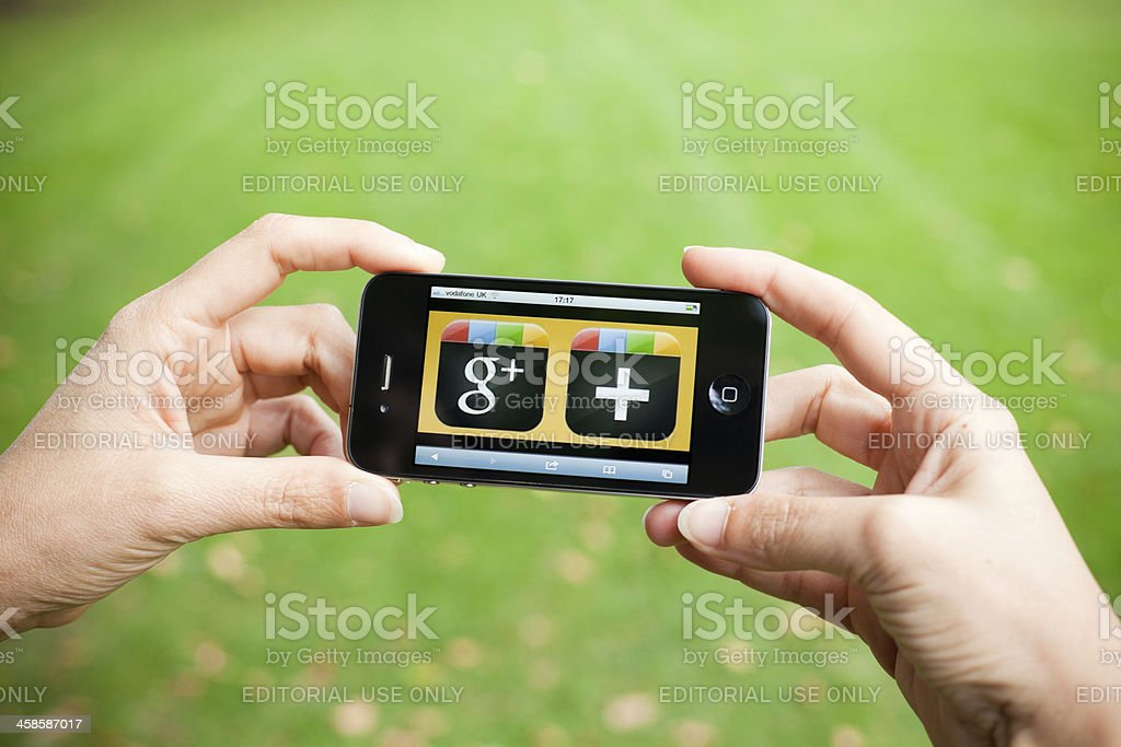 Google Plus on Iphone 4, Outdoors royalty-free stock photo