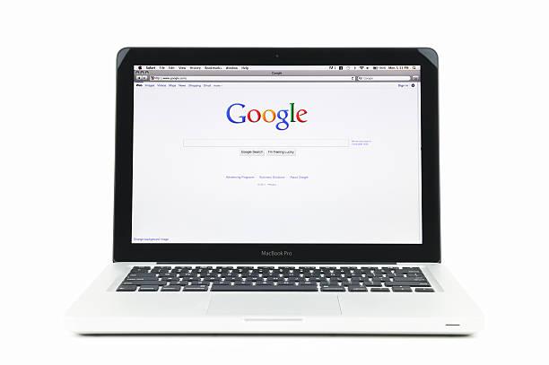 google の検索エンジンのホームページのマックブック pro - グーグル ストックフォトと画像