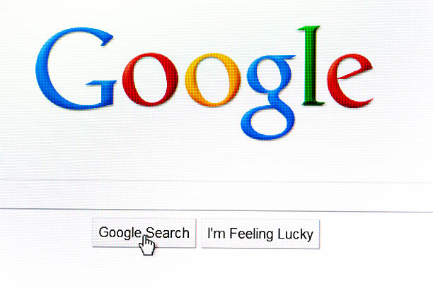 """Google search page in the internet Kyiv, Ukraine  - February 20, 2011: Google logo in the browser page and mouse pointer over \""""Google search\"""" button. Photo was taken on computer monitor. Google is the biggest search engine in the internet.  google stock pictures, royalty-free photos & images"""
