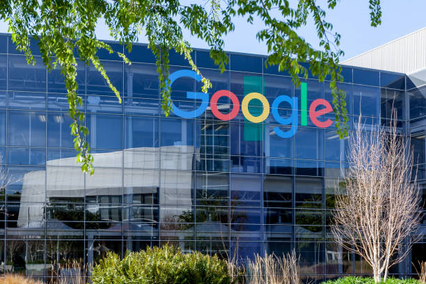 Google sign on the building at Google's headquarters in Silicon Valley . Mountain View, California, USA - March 29, 2018: Google sign on the building at Google's headquarters in Silicon Valley . Google is an American technology company in Internet-related services and products. google stock pictures, royalty-free photos & images