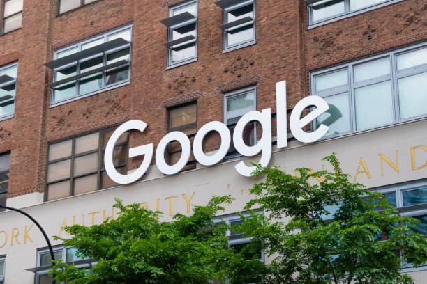 google sign outside the google office in new york city - google стоковые фото и изображения