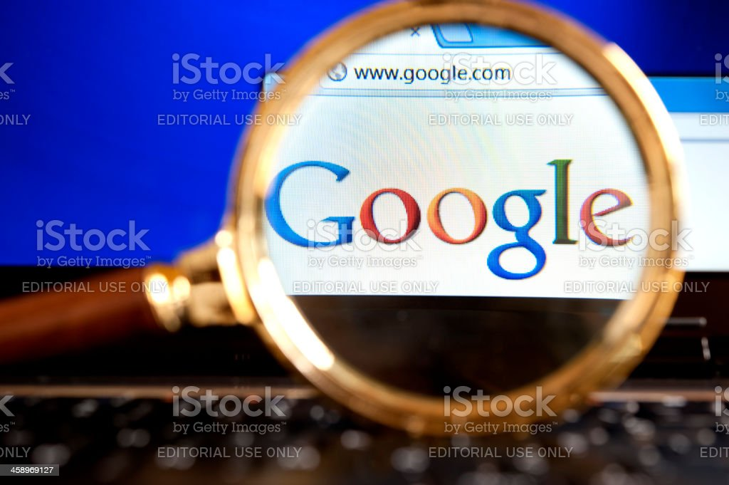 Google website through a magnifying glass stock photo