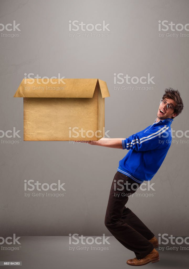 Goog-looking man holding an empty brown cardboard box stock photo