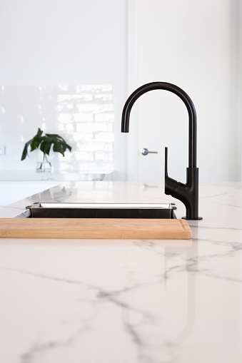 Goose neck black tapware in a stunning white kitchen