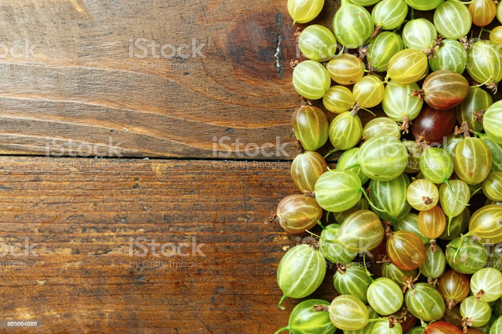 Gooseberries on a wooden background stock photo