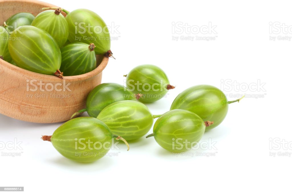 Gooseberry in wooden bowl isolated on white background stock photo