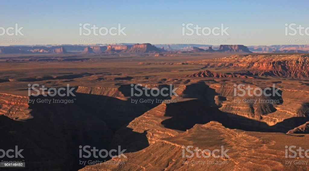 Goosenecks State Park and Monument Valley, view from Muley Point right after sunrise, USA stock photo