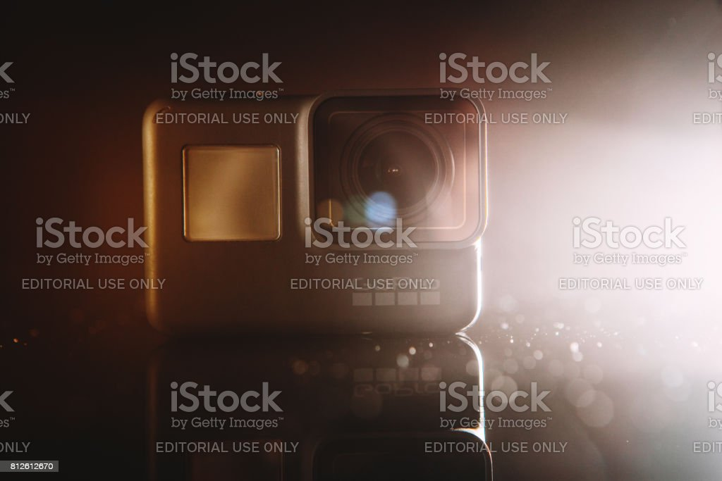 GoPro HERO 5 digital action camera in spotlight with lensflare on...