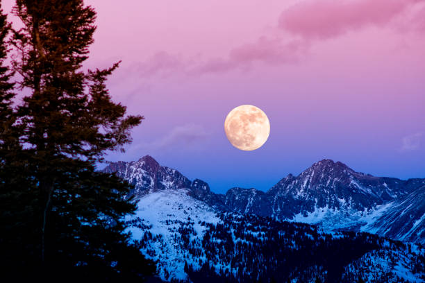 Gore Range Sunset Moonrise Gore Range Sunset Moonrise - Scenic landscape with full moon rising. vail colorado stock pictures, royalty-free photos & images