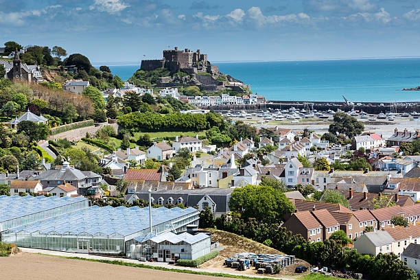 Gorey, Jersey, UK View to Mont Orgueil Castle with harbour in Gorey, Jersey, UKView to Mont Orgueil Castle with harbour in Gorey, Jersey, UK sea channel stock pictures, royalty-free photos & images