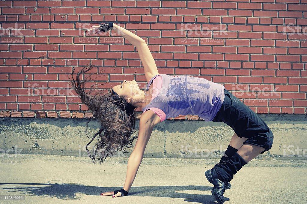Gorgeous adolescent girl hip hop dancing stock photo