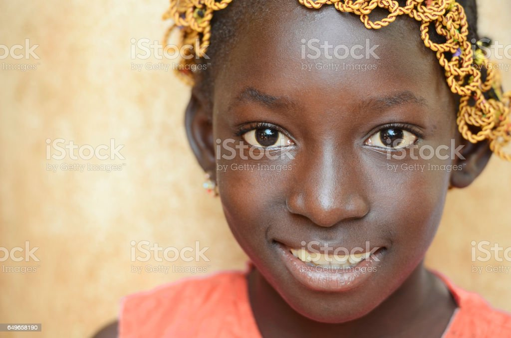Gorgeous African beauty portrait with light smile outdoors in Bamako, Mali stock photo