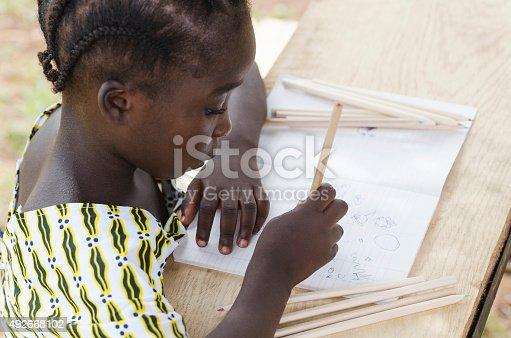 istock Gorgeous African Schoolgirl Drawing in her Workbook (Back to School) 492668102