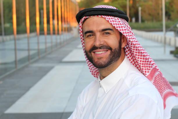 gorgeous arabic businessman smiling in office space - seduzione foto e immagini stock
