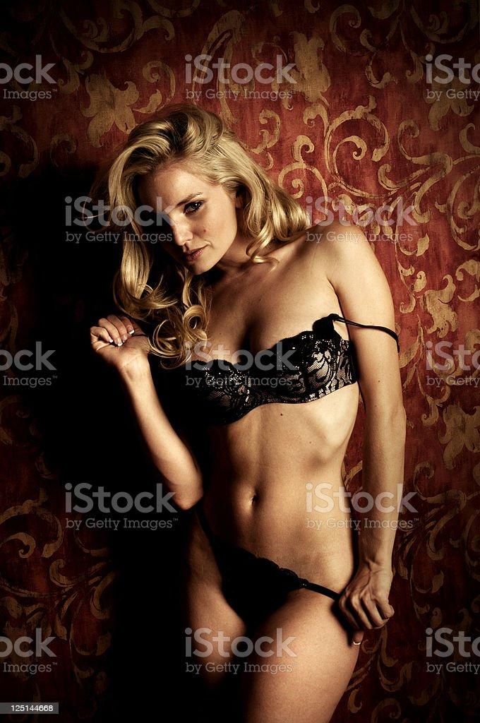 Gorgeous Blonde Model in Black Lingerie stock photo