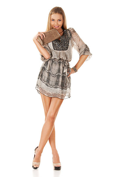 gorgeous blonde posing in mini dress - mini dress stock photos and pictures