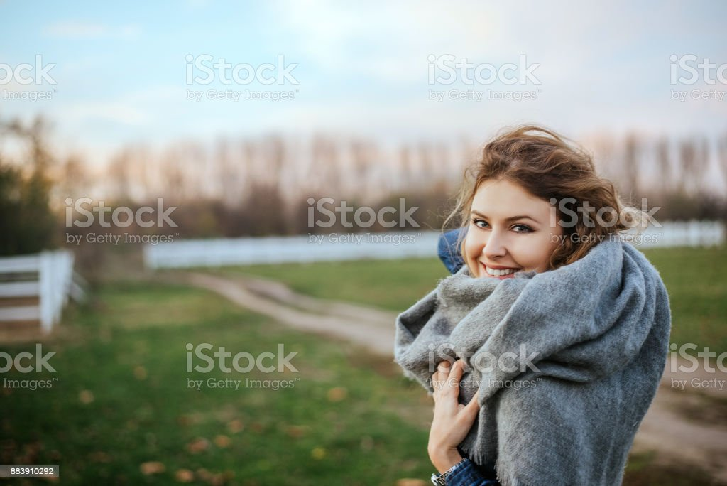 Gorgeous blonde woman posing outside at autumn field. stock photo