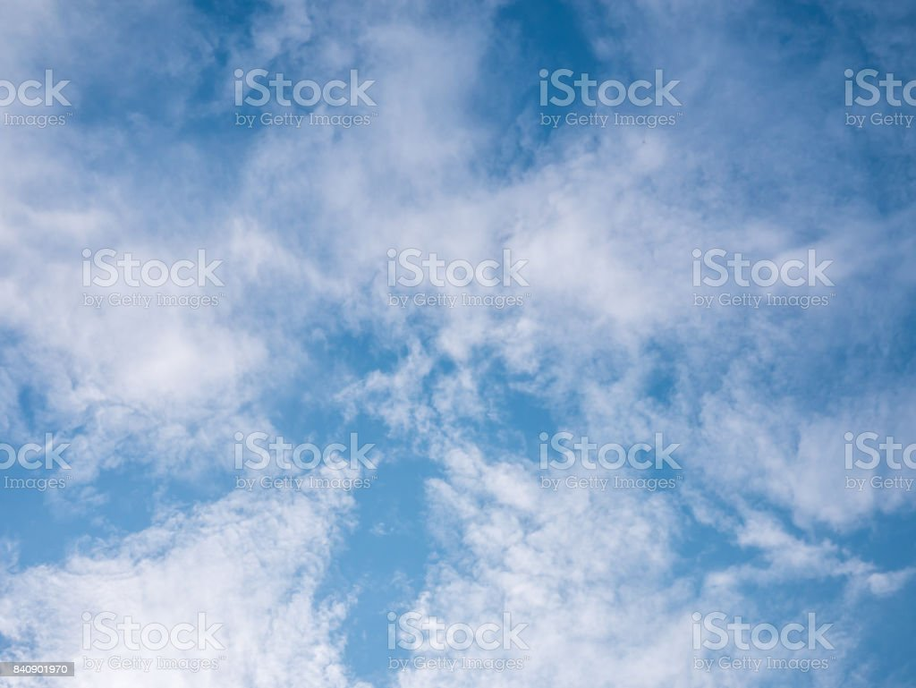 Gorgeous blue cloudy sky background stock photo