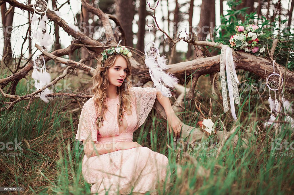 Gorgeous Boho Bride With Dream Catchers In Forest - Photo