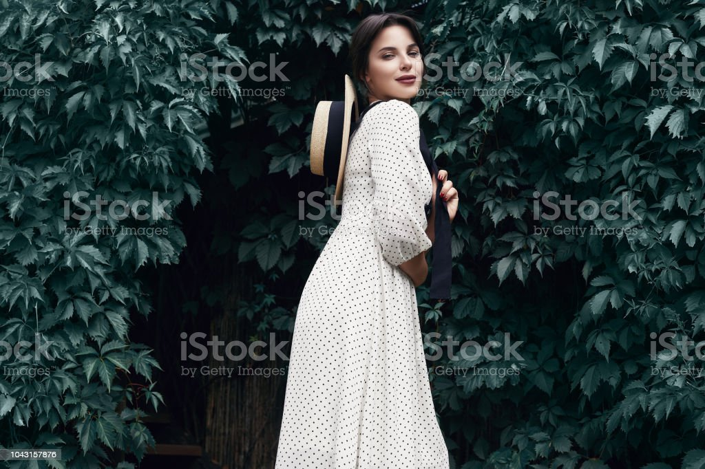 39de28f43b9 Gorgeous bright brunette woman in fashion dress with straw hat - Stock  image .