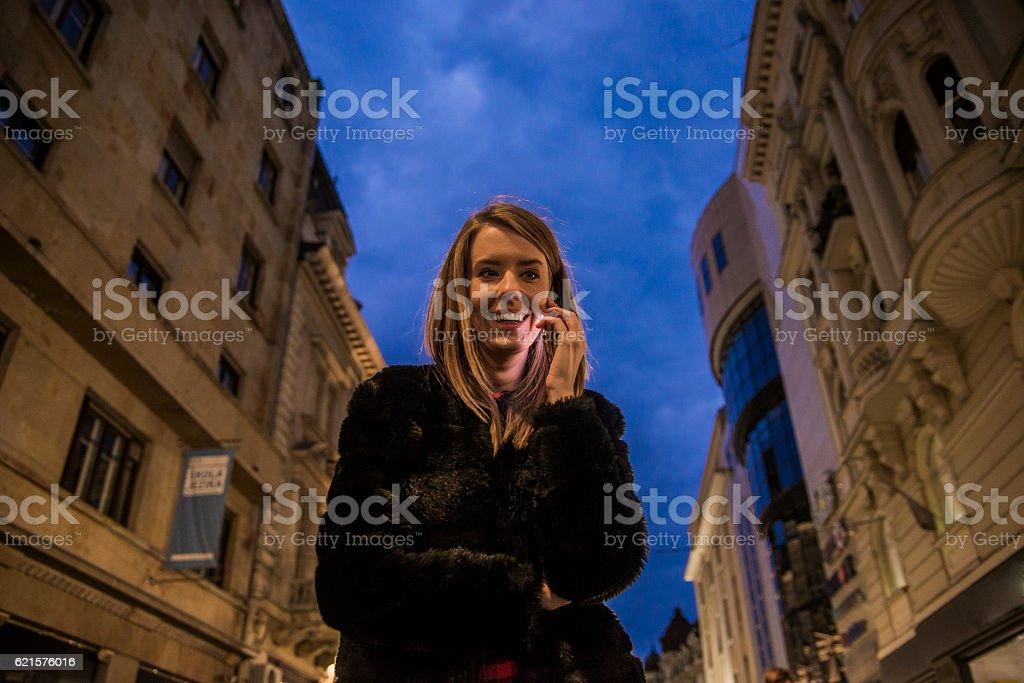 gorgeous brunette girl, portrait in night city lights. stock photo