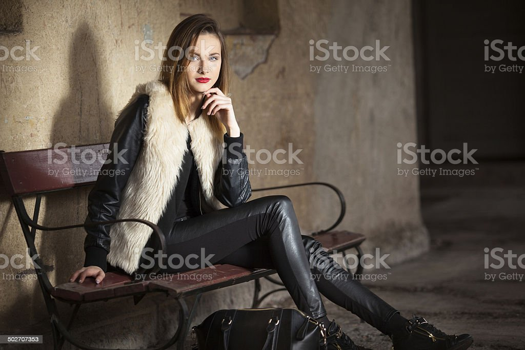 Gorgeous brunette standing on the train station with her luggage stock photo
