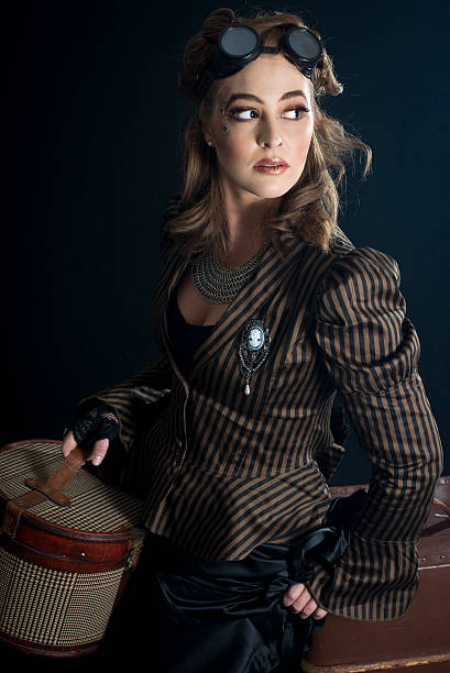 gorgeous brunette steampunk woman - steampunk fashion stock photos and pictures