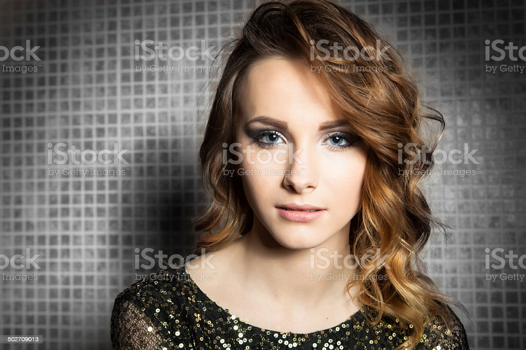 Gorgeous Brunette Woman With Curly Hair And Blue Eyes Portrait Royalty Free Stock Photo
