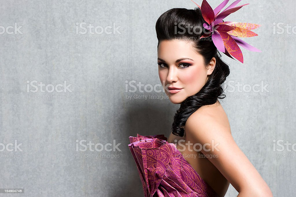 Beautiful Woman In Floral Gown With Hairstyle And Makeup