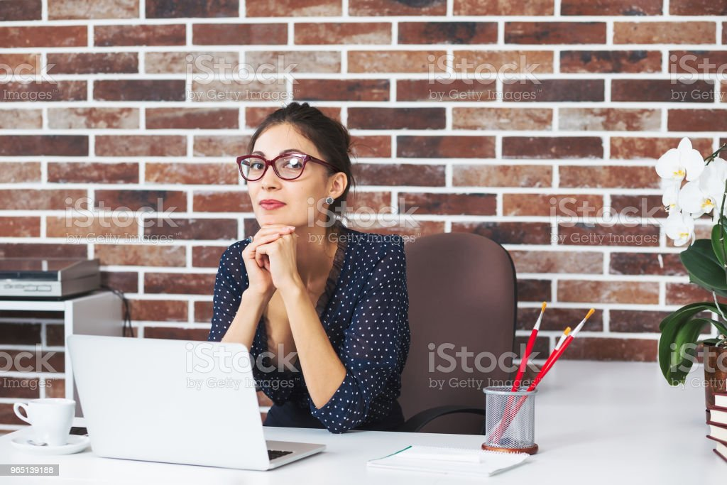 Gorgeous business woman in office looking to camera zbiór zdjęć royalty-free