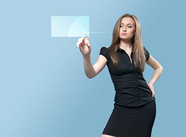 Gorgeous businesswoman touching future interface stock photo