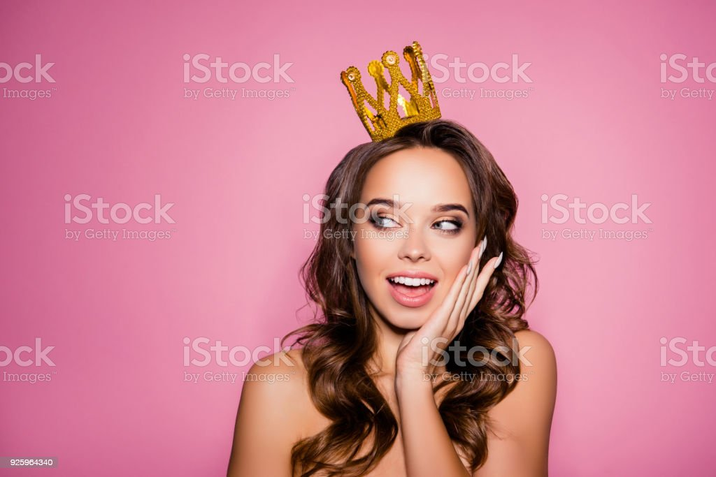 Gorgeous charming girlish dreamy lady with ideal face with wonderment grimace, amazing wavy nice modern trendy hairstyle, full pink lips, so sexy, holds arm palm on her cheek, long nails nice manicure stock photo